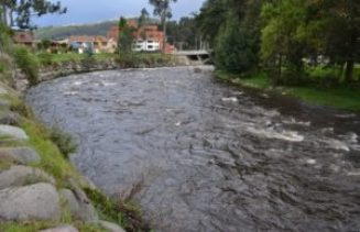 High water on the Rio Tomebamba on Cuenca's westside.
