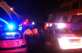 Rescue workers on the scene at Loja house collapse that killed six.