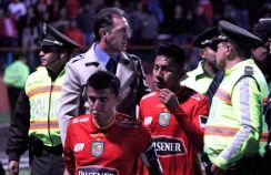 Dejected Cuenca players walk off the pitch Wednesday night.