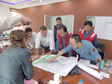 Chinese company officials review mine plans last week in Zamora Chinchipe .