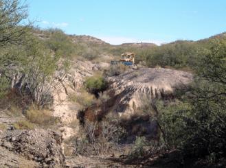Bulldozer at work pushing the dirt to make berms