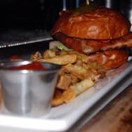 Crispy Fried Pork Chop Sandwich at The Basement Tavern