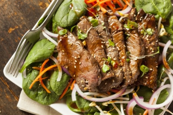 23670012 - asian sliced beef salad with spinach and carrots