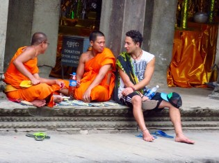 Angkor Wat–Buddhist monks and tourist