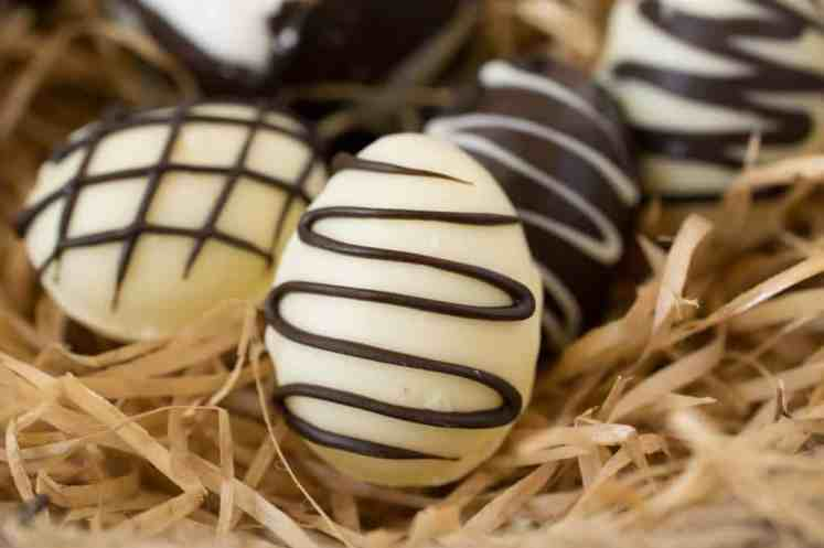 Easter chocolate creme eggs are a fun and festive Easter treat. Dark and white chocolate shells are filled with a marshmallow creme and yellow yolk. Have fun making them for and with your kids.