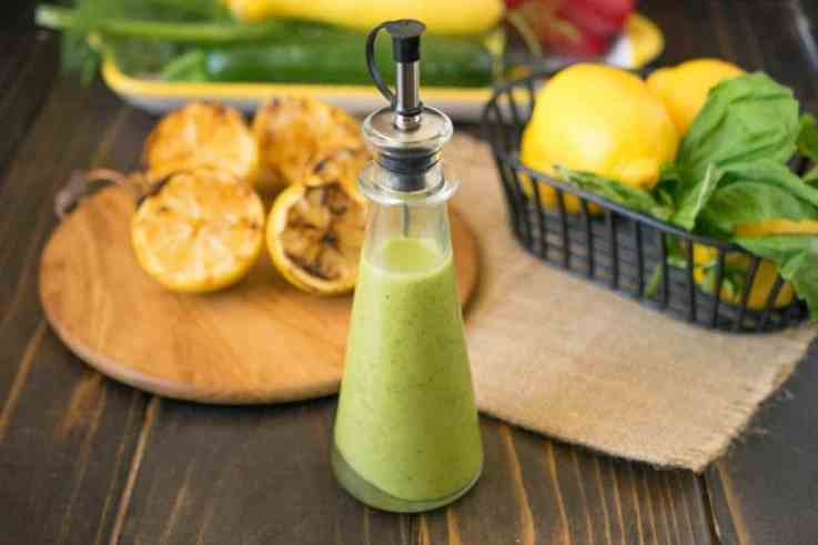 Grilled lemon & basil vinaigrette is a delicious and light summer salad dressing or dip.  Fresh lemons are grilled until they get caramelized and sweet then the juice is blended with fresh basil and parsley for a lovely warm weather recipe.