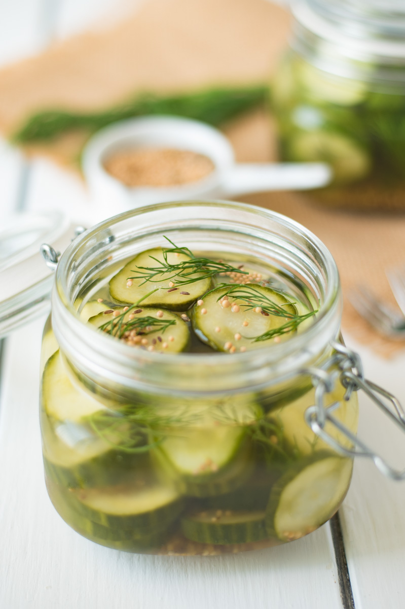 An open jar of dill pickle chips