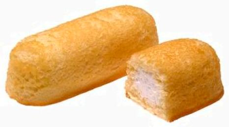 closeup of Hostess Twinkies snack cakes, one split open