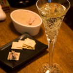 champagne in flute with crackers and pate