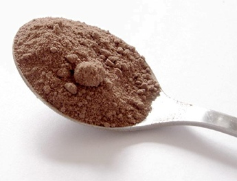 cocoa powder on spoon