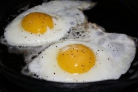 eggs frying in pan