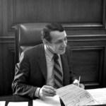 Harvey Milk working at Mayor Moscone's desk