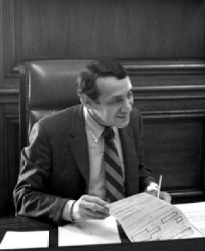 Harvey Milk working at Mayor Moscone's desk
