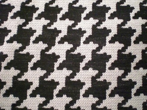 Closeup view of houndstooth fabric pattern.
