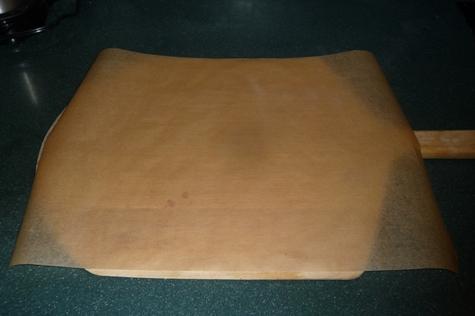 parchment paper on pizza peel for sliding