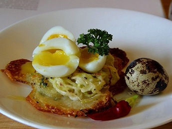Soft boiled quail egg on potato galettes
