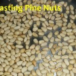 pine nuts toasting in pan
