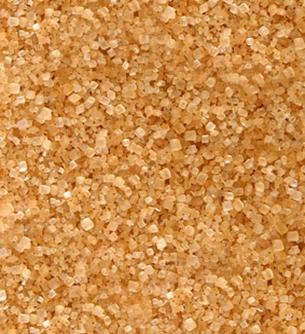 closeup photo of turbinado, demerara, or raw sugar showing texture