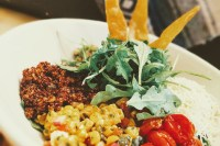 Healthy Latin Bowl with Red Quinoa, Guacamole, Florida Sweet Corn Salad, Roasted Tomatoes & Quesadilla Cheese
