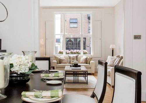 An example of interiors consultancy - A classic contemporary dining room which leads into a reception room home staged by Cullum Design   London UK