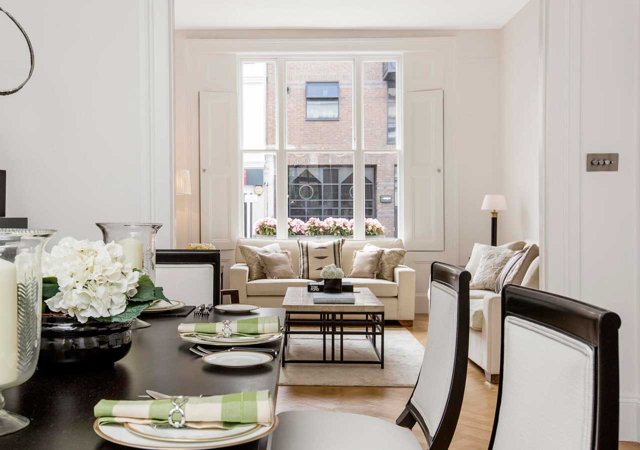 A classic contemporary dining room which leads into a reception room home staged by Cullum Design   London UK