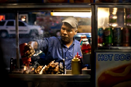A New York City street vendor selling hot dogs.