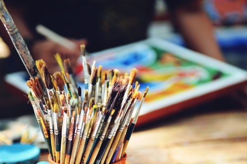 A photo of an artist painting.