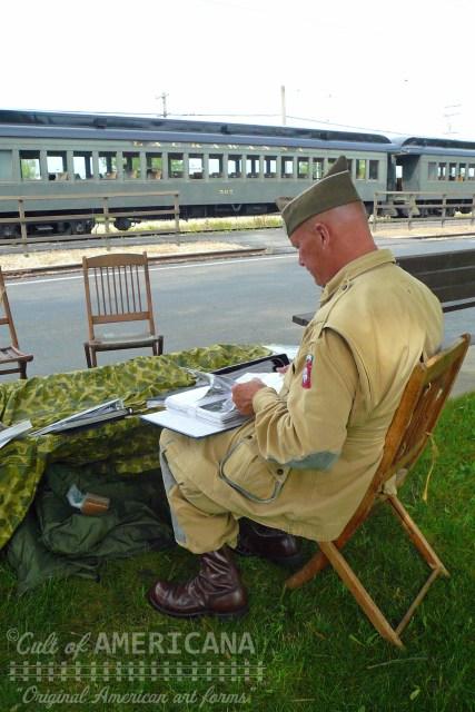 Veteran Sits Besides a Train