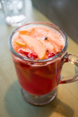 A cranberry beverage, served hot. Very similar to sangria without the ice or wine. The fruit juice-soaked apples are a dessert in themselves!