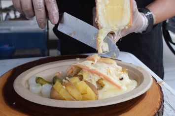 Raclette - melted cheese over potatoes and vegetables.