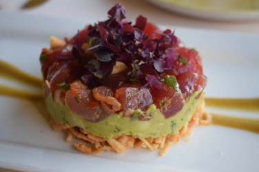Our favorite appetizer: deconstructed poke with avocado and crispy won tons