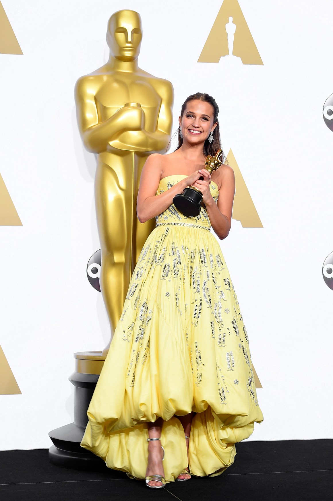 HOLLYWOOD, CA - FEBRUARY 28: Actress Alicia Vikander, winner of the award for Best Actress in a Supporting Role for 'The Danish Girl,' poses in the press room during the 88th Annual Academy Awards at Loews Hollywood Hotel on February 28, 2016 in Hollywood, California. (Photo by Steve Granitz/WireImage)