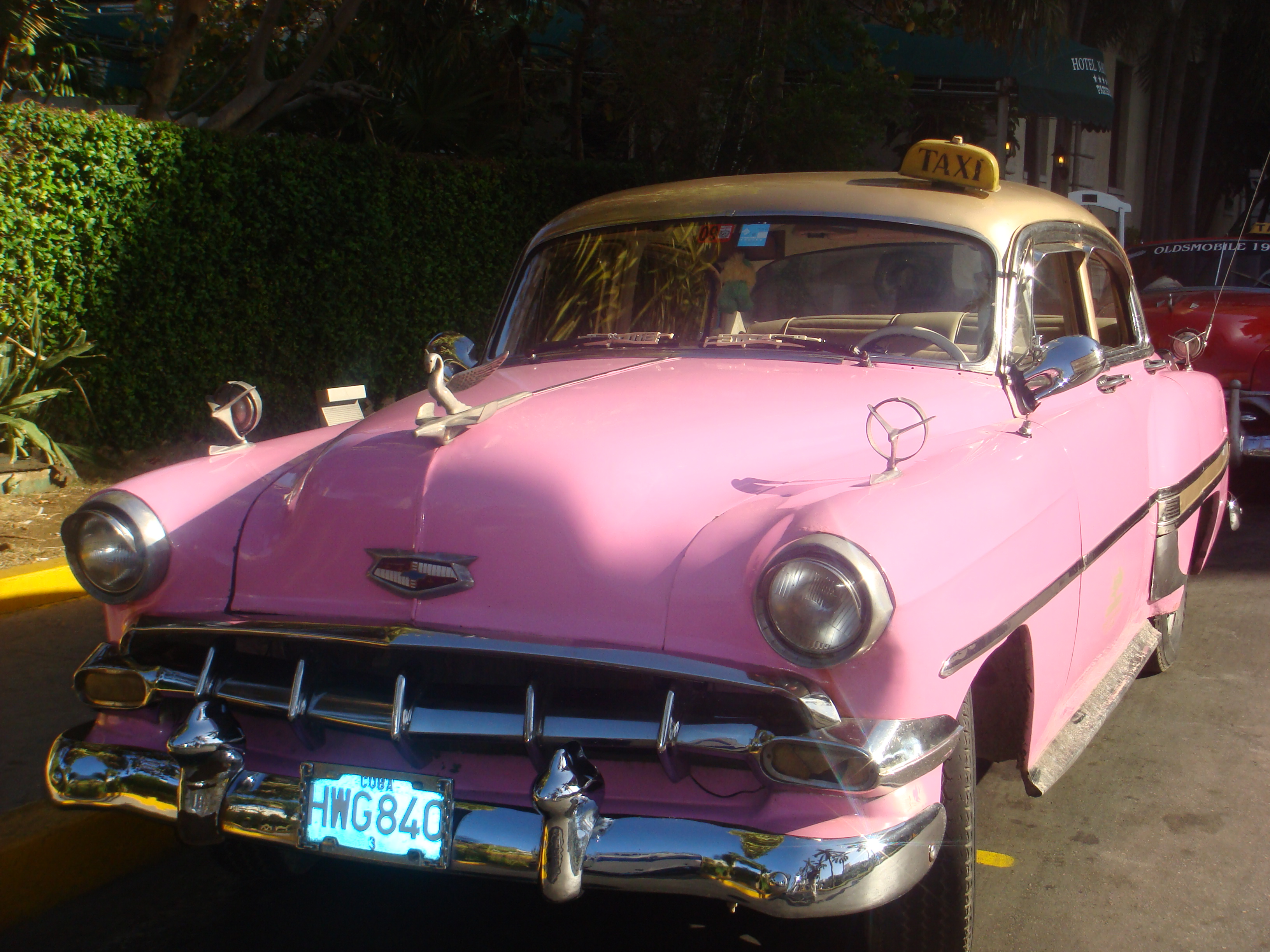 Old fashioned pink taxi car in Cuba