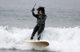 "Heather Blanda competes dressed as ""Edward Scissorhands"" in the ZJ Boarding House Halloween Surf Contest in Santa Monica, California"