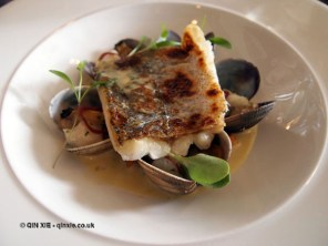 Fillet of hake with clams, cod cheek, mushroom and shallots at Catch and Cook with Simon Hulstone in Torquay