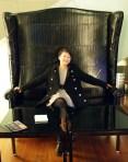 Qin Xie in giant chair, Geneva