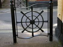 Ship wheel railing in Aldeburgh, Suffolk