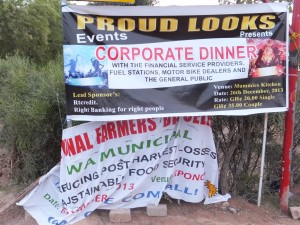 """Signs of the times: Here a banner advertising festivities for the annual Farmer's Day sags and crumples below a banner advertising a """"corporate dinner"""""""
