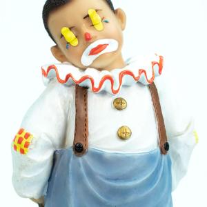 clown figurine, child clown in baggy blue pants, closeup