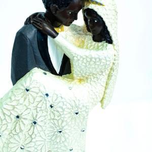 wedding couple figurine, groom holding bride, closeup