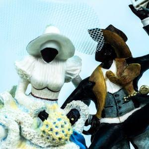 wedding couple figurine, couple jumping broom, closeup