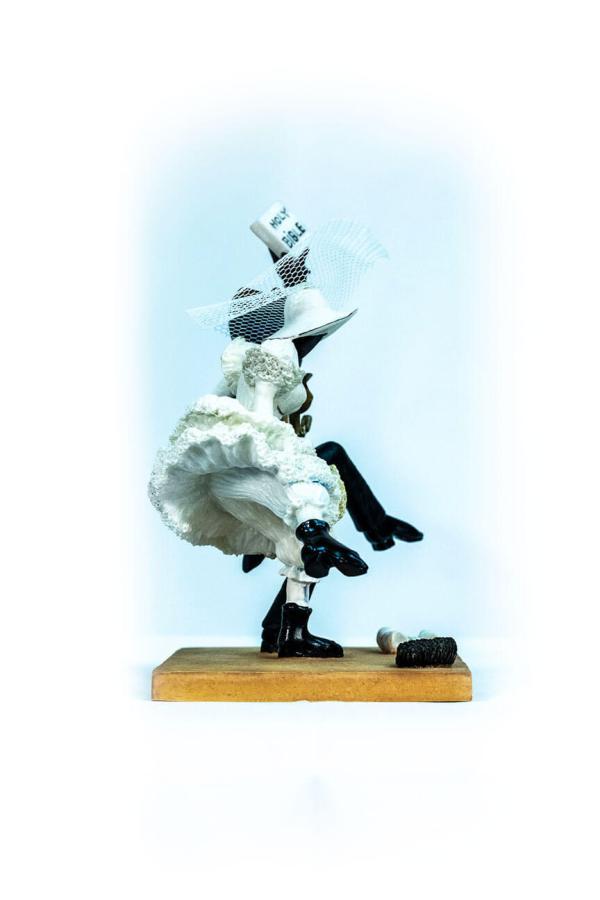wedding couple figurine, couple jumping broom, right