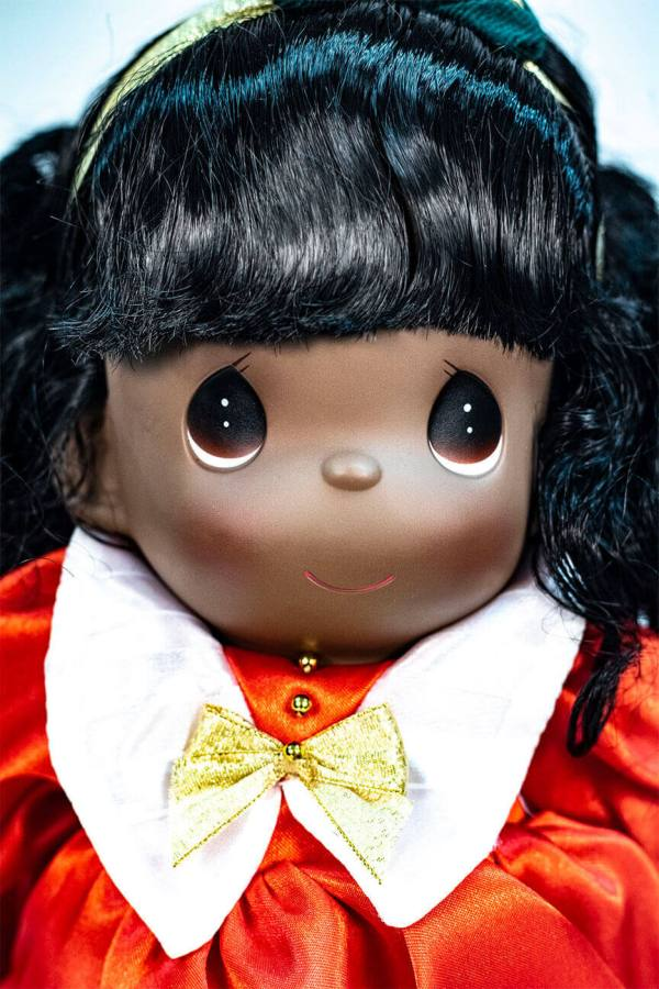 doll, baby doll sitting in red dress, closeup view2