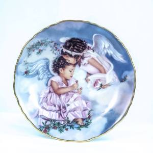 collectible plate with two cupids, closeup