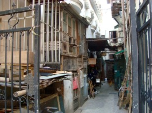An old alleyway leads to a housing complex (Shanghai)