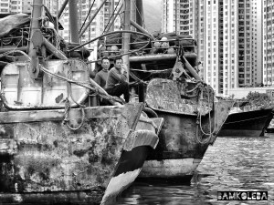 """I went on a boat cruise in Hong Kong and I thought it will be a great fit for my 'People at Work'  collection and I liked the juxtaposition of  old, rusty fishing boats and the cosmopolitan city just right behind it """