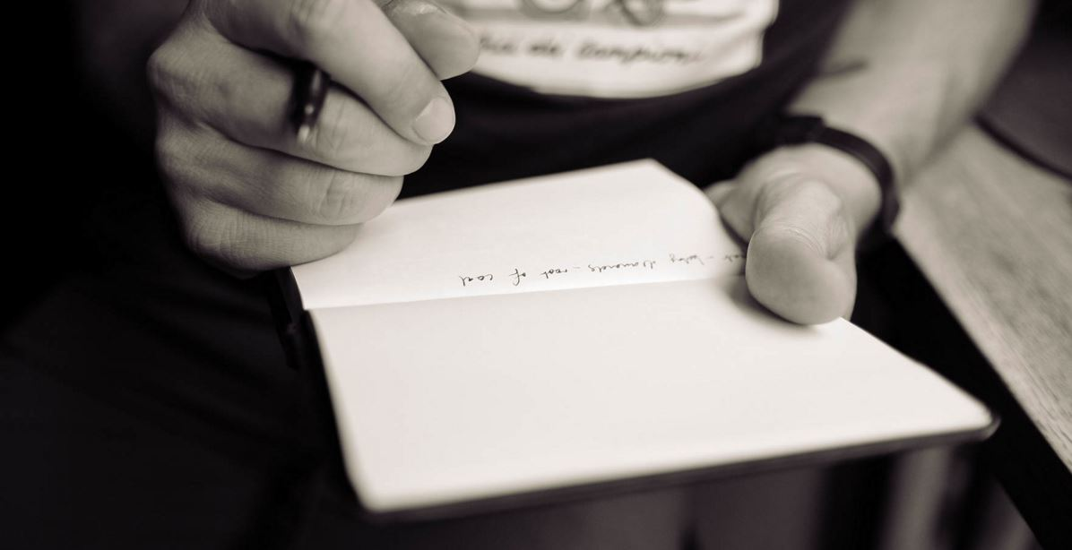 writing on a notepad