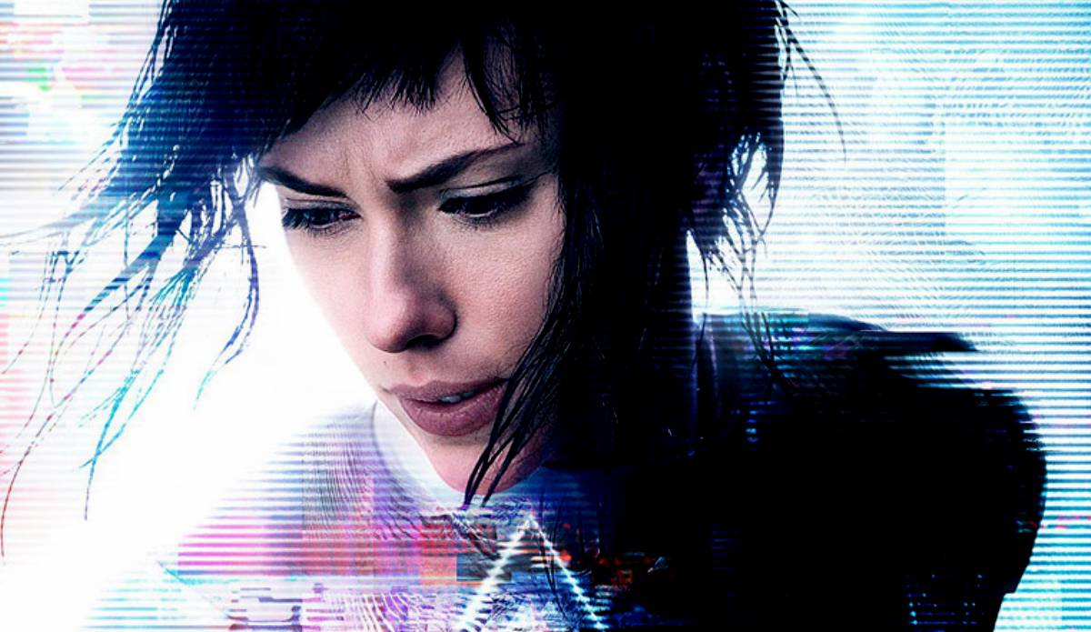 A poster shot for Ghost in the Shell, showing Scarlet Johanssen in a dark wig, with distorted digital manipulation