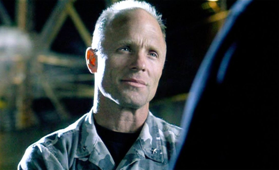 "bad guys The movie ""The Rock"", directed by Michael Bay. Seen here, Ed Harris (as General Francis Hummel). Theatrical release June 7, 1996. Screen capture. Copyright © 1996 Hollywood Pictures Company, Don Simpson Productions, Inc. and Jerry Bruckheimer, Inc. Credit: © 1996 Hollywood Pictures / Courtesy: Pyxurz."