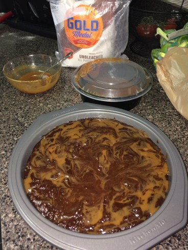 Just after adding the dulce de leche to the brownie batter.